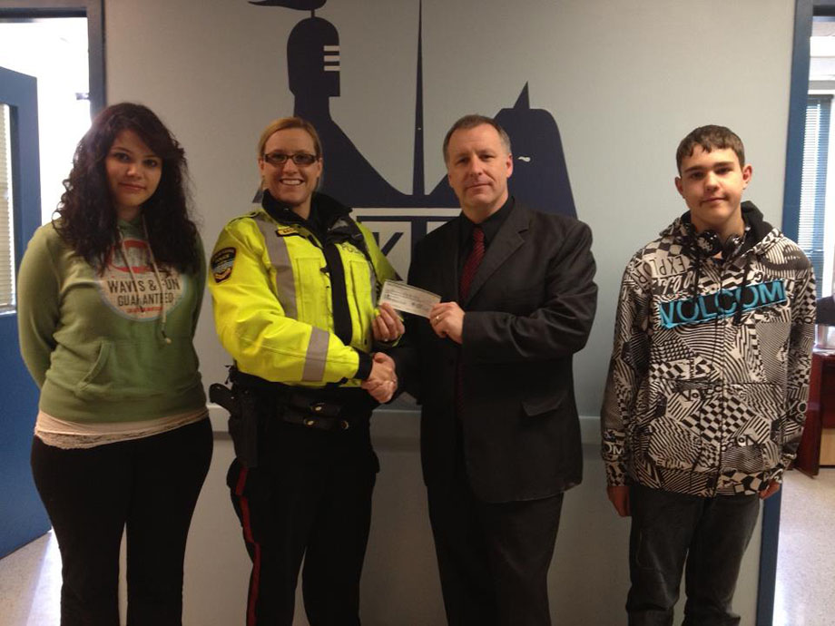 Cst. Anika Becker presenting a cheque for the KVHS TADD group.