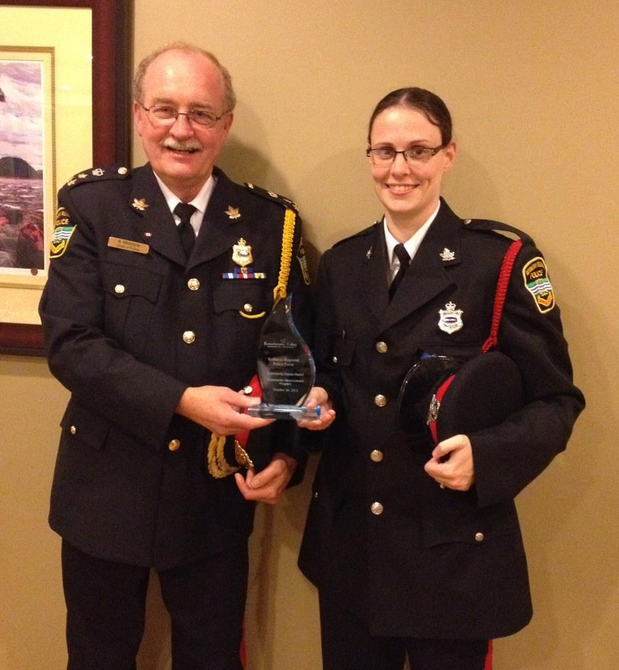 Chief Stephen McIntyre and Cst. Krystal Daley receive an award for Community Impact.